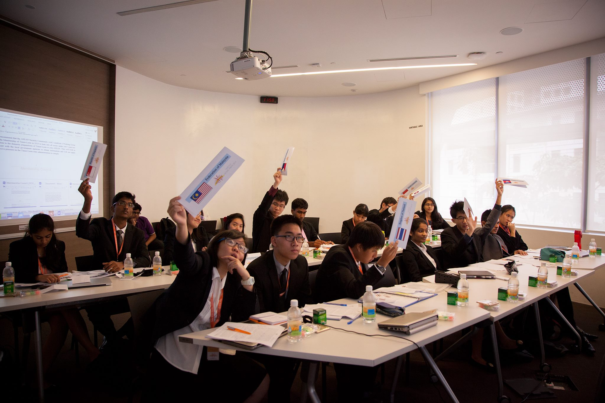 Model ASEAN delegates vote on the Chairman's Statement in the Membership Council.