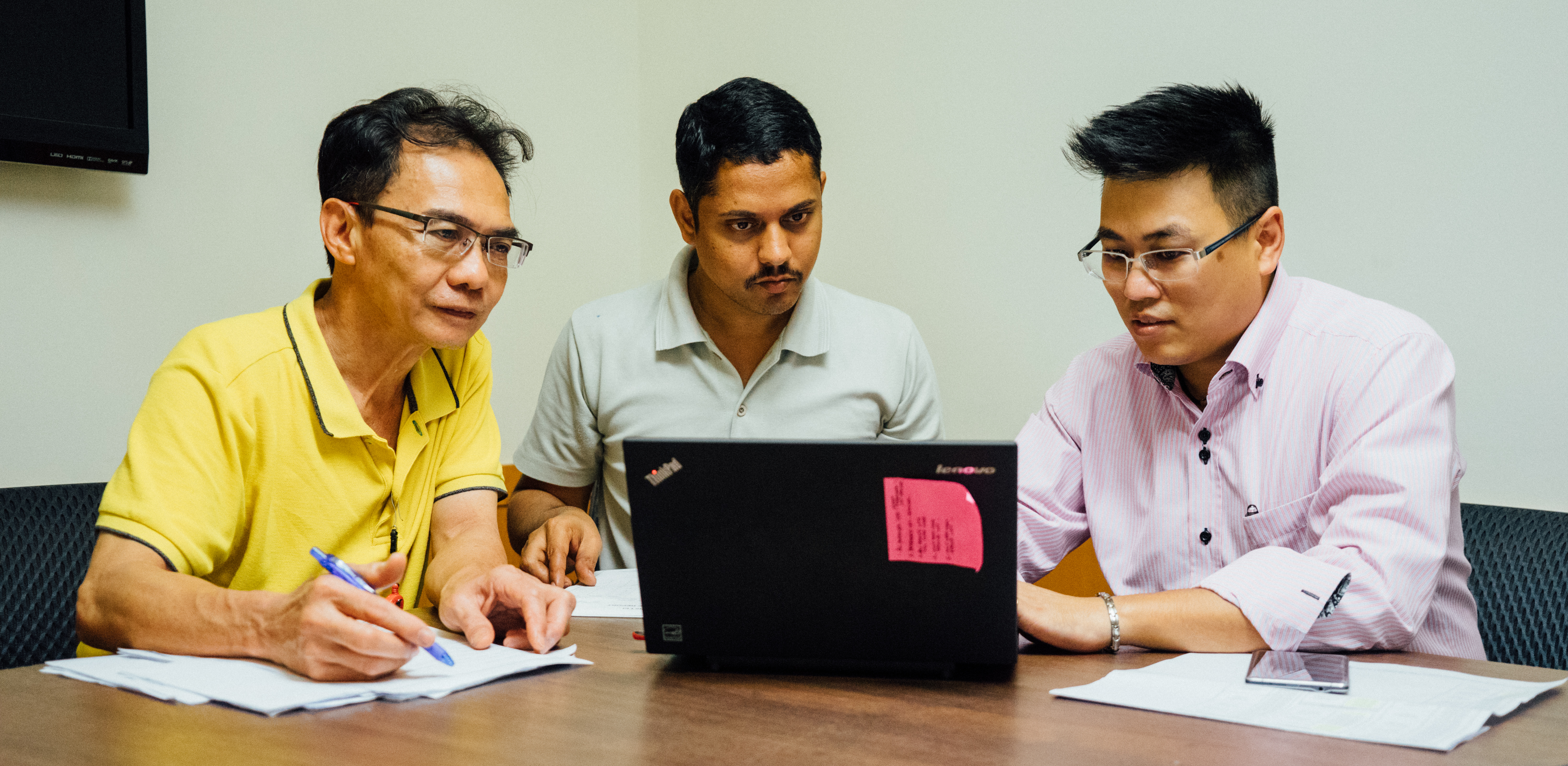 From left to right, Lau Cheng Yeow, Mohan Prasanna and Eugene Tan: the Facilities team, hard at work.