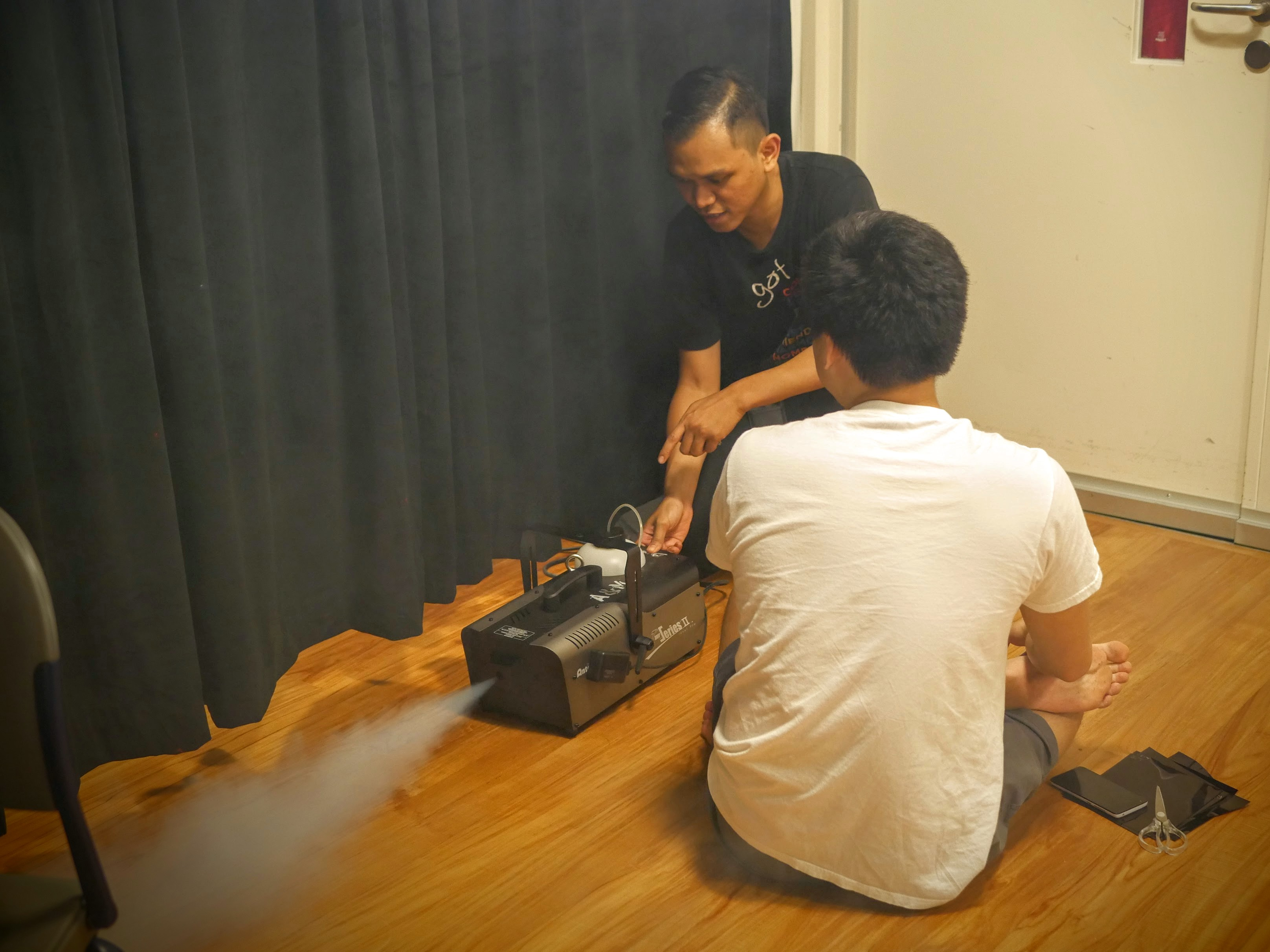 Gabriel Lim '19 tests out a smoke machine with A&M staff.