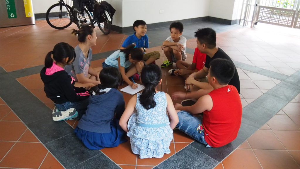 A KidAccomplish class is hosted outside in the Cendana courtyard.