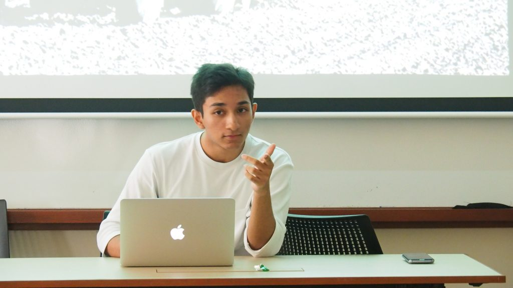 Aditya Karkera '20, a KidAccomplish volunteer, hosts a seminar on economics.