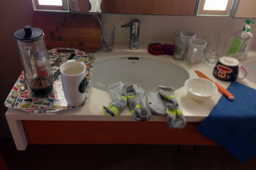 Socks and dirty dishes sit in the suite toilet. A prime example of a lack of civic responsibility.